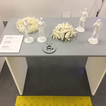 A desk with 3D printed statues