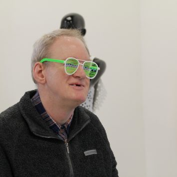 Another angle of a man wearing green 3D printed glasses