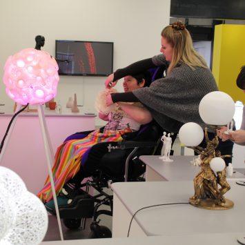 wheelchair bound woman is shown exhibit