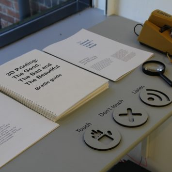 Braille and large print documents on a table