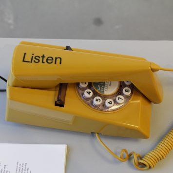 A mustard yellow trim-phone close up