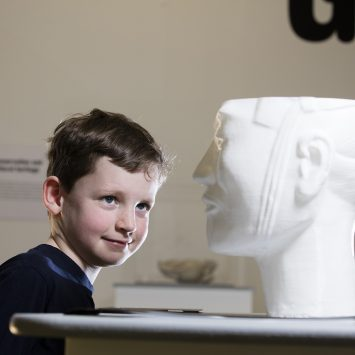 A child examines the Terracotta warrior bust